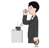 2.遺影に向かって一礼し、合掌。右手の親指と人差し指、中指の3本で抹香をつまみます。