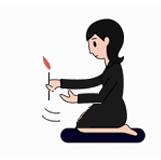 2.線香を1本取り、ろうそくで火を付け炎を手で仰いで消します