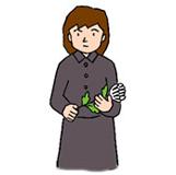 3.花の根元が祭壇に向くように持ち替え献花台に両手で捧げます。